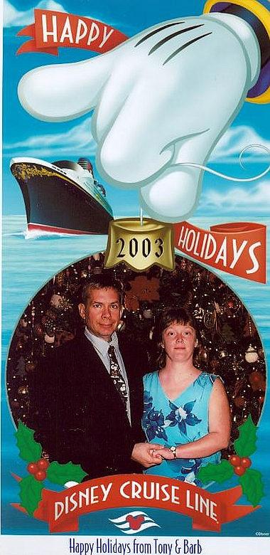 left is our christmas card for 2003 were done on the ship they featured a photo of us standing in front of the christmas tree in the atrium